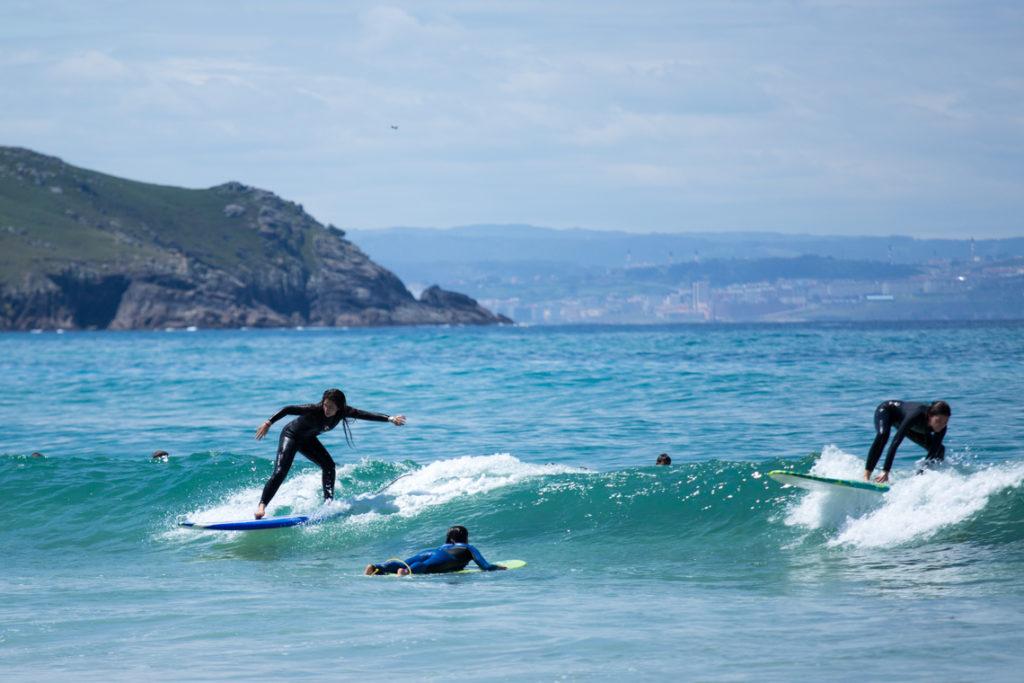 Surfers learning Praia de Doniños